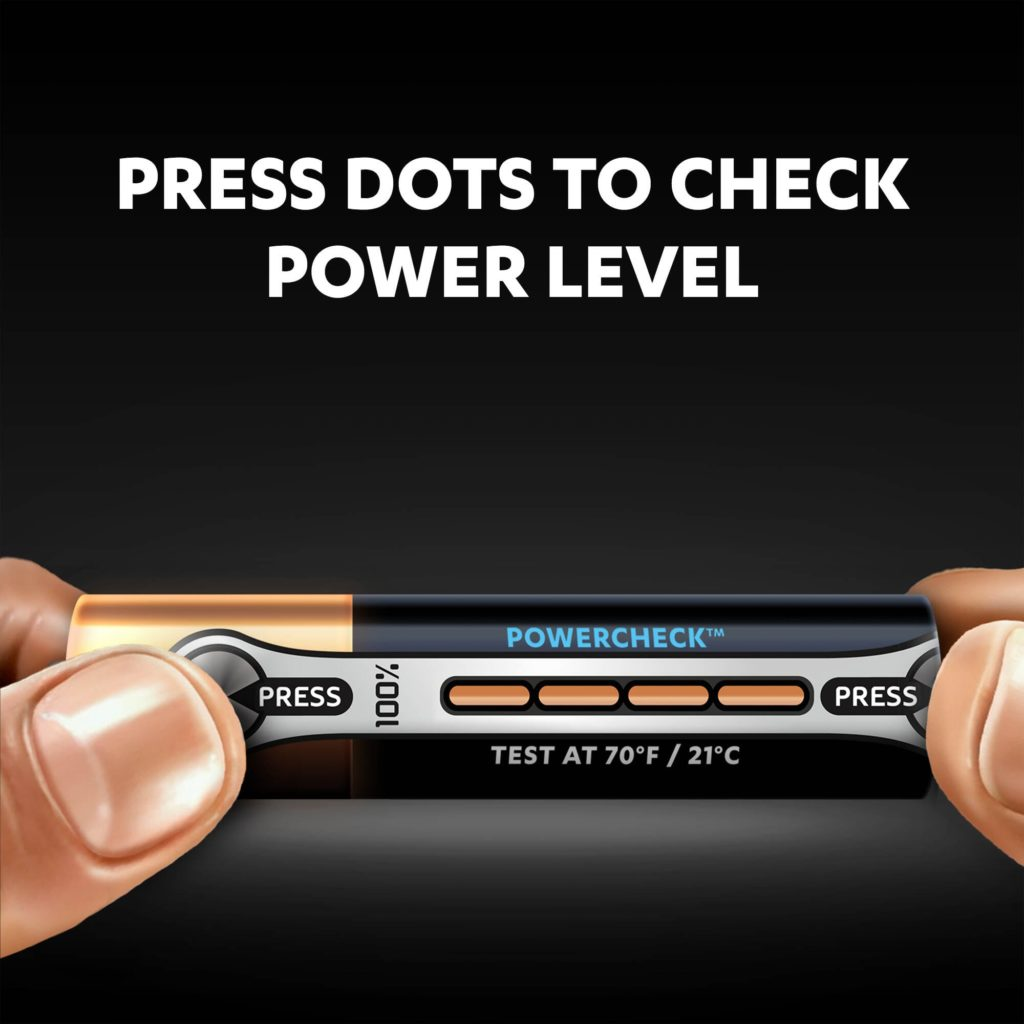 Fingers holding Duracell Alkaline Type Ultra AAA battery with POWERCHECK indicator